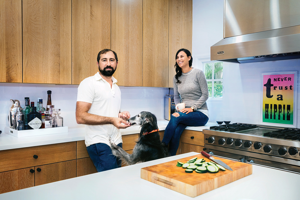 Chris and Kristen Vila relax in their Palm Beach home with their dog, Steve.